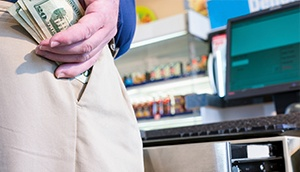 Employee Stealing Cash